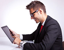 Image shows an employee holds an iPad